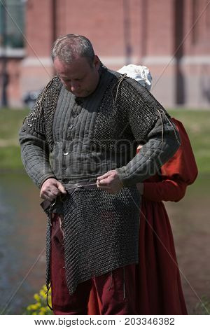 ST. PETERSBURG, RUSSIA - JULY 8, 2017: Participant of armored knight tournament preparing to the battle during the military history project Battle On Neva. It's the 4th such event