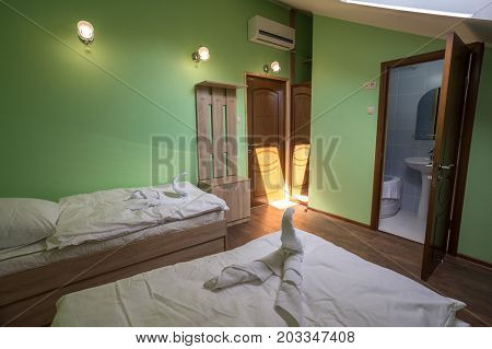 room in a hotel, a modest apartment with a bathroom