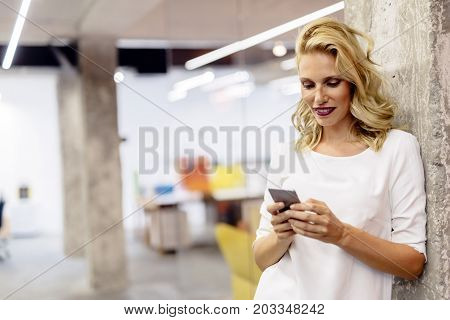 Beautiful woman using mobile phone to brows the internet