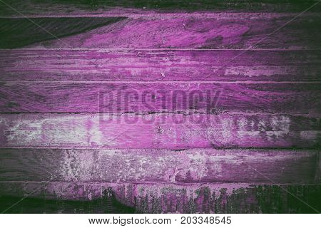 Magenta abstract background and texture for designers. Texture of vintage handmade pink table.