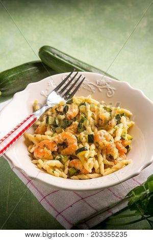 trofie with zucchinis and shrimp, selective focus