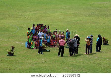 Thai dance performances of students in the stadium Darunothai School Trang Thailand August 19 2016