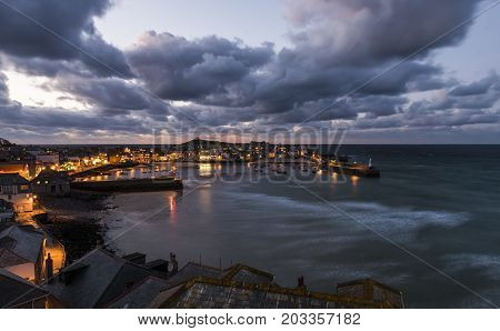 Saint Ives England - April 29 2017: Night in the harbor city and beach of Saint Ives in Cornwall England.