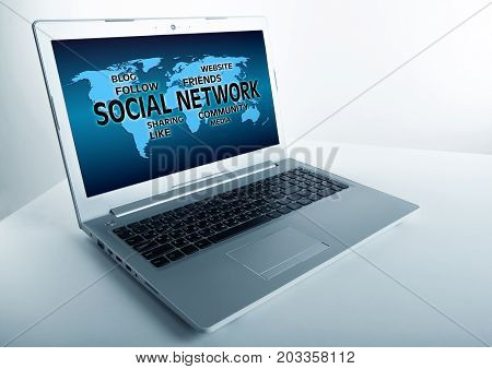open grey laptop with inscription social network