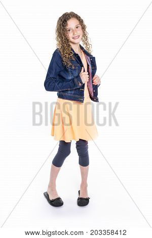 A Portrait of happy, smiling, confident 9 years old girl with curly hair, isolated on white