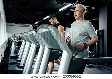 Sportsmen Running On Treadmills