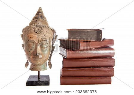 Philosophy and wisdom. The philosopher Buddha with ancient theology text books. Religious education and ethics.