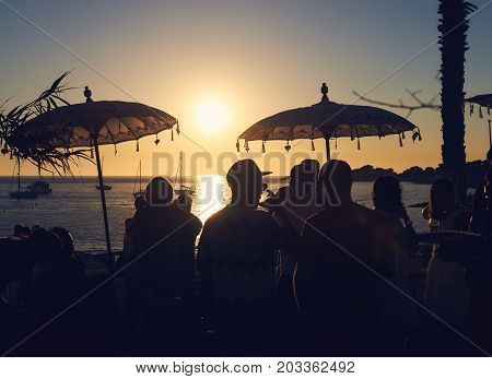Ibiza, Spain - June 11, 2017: People during the sunset on the Calo des Moro in Ibiza. Balearic Islands. Spain