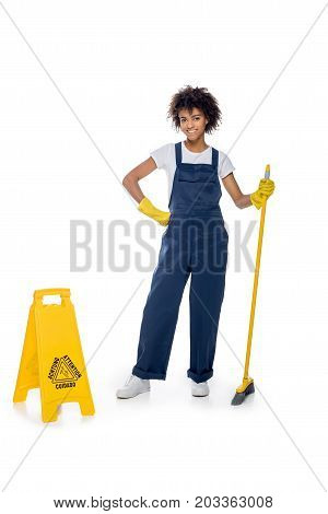 African American Female Cleaner With Broom
