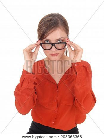 A young woman in a red blouse looking over her black frame glasses into the camera isolated for white background