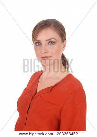 A portrait image of a beautiful young woman standing in a red blouse with her hair back looking in camera isolated for white background