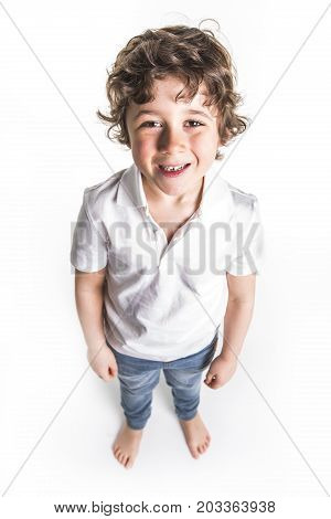 A kid portrait with curly hair on studio