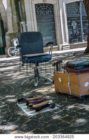 Shoeshiner Equipments In The Street: Chair, Wooden Footrest, Brushes And Rag