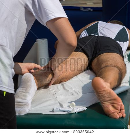Athlete's Calf Muscle Professional Massage Treatment after Sport Workout: Fitness and Wellness