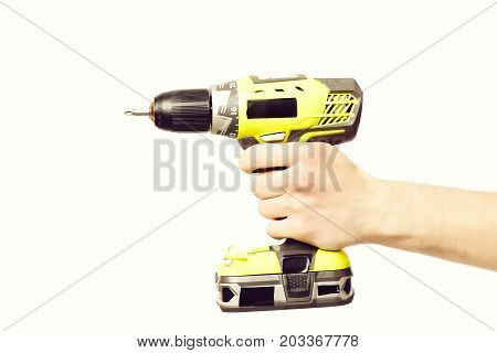 Tool For Drilling In Yellow Color Held In Males Hand