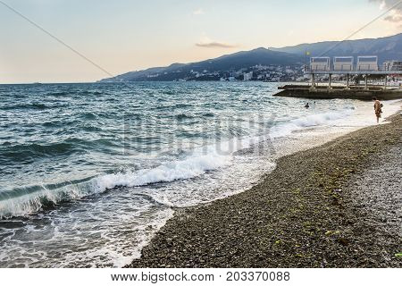 Yalta, Crimea - 11 July, An uneasy sea by the shore, 11 July, 2017. Surroundings and adjacent areas of the hotel Yalta Intourist.