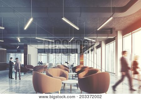 Waiting area of an office with beige armchairs standing around coffee tables in an office lobby with panoramic windows. Open space rooms background. People. 3d rendering toned image