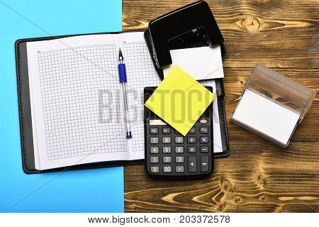 Stationery And Open Leather Covered Notebook As Business Concept