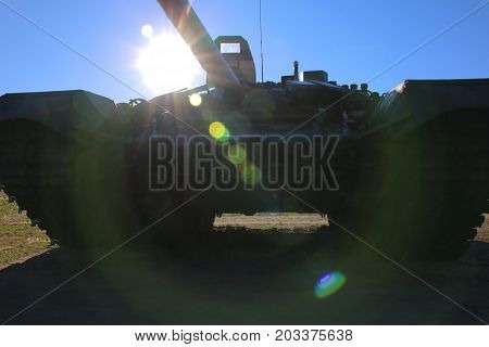 Russian military tank in the backlight of the sun
