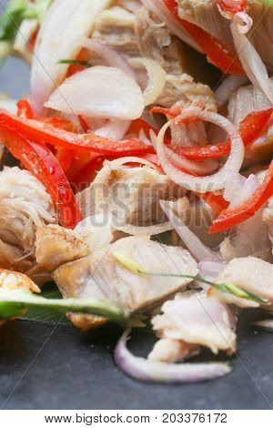 Close up view of pork salad with vegetable