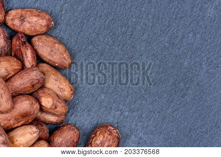 Heap of cacao beans on slate close-up