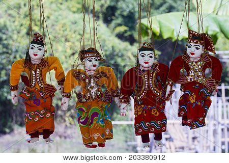 Traditional handicraft puppets are sold in a market in Bagan Myanmar