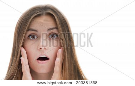 Beautiful girl showing surprise holding hands near face on isolated white background