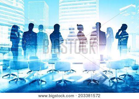 Abstract silhouettes of businesspeople in meeting room with city view. Communication concept. Double exposure