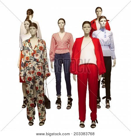 Group of female mannequins wear fashionable clothes isolated white background. No brand names or copyright objects.