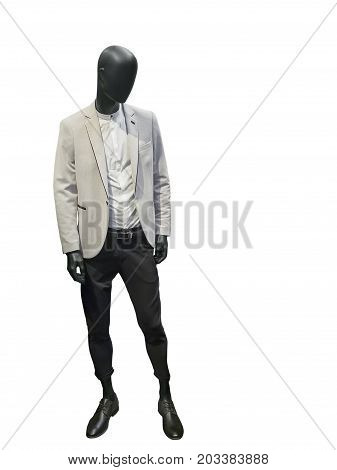 Full length male mannequin dressed in white coat and black trousers isolated on white background. No brand names or copyright objects.