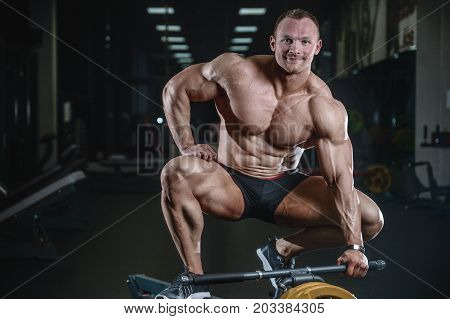 Handsome Model Young Man Training Back In Gym