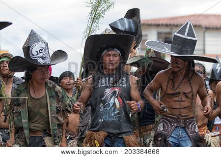 June 29 2017 Cotacachi Ecuador: kichwa indigenous people dancing on the street during Inti Raymi festival