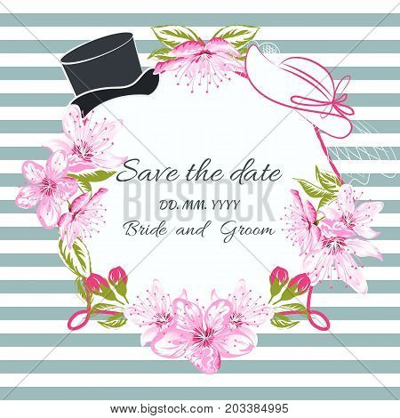 Wedding hats bride and groom on frame of Cherry blossom on striped background