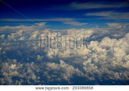 Cumulus clouds. The picture was taken from a height of 10 000 meters. Huge atmospheric education. Harbingers of rain and storms. White drifts in the sky. Aerial photography.
