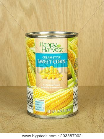 RIVER FALLS,WISCONSIN-SEPTEMBER 08,2017: A can of Happy Harvest brand creamed sweet corn with a wood background.