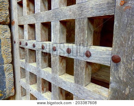 Close up of the trellis design on a medieval door, located at Chateau de Commarque, Dordogne, France