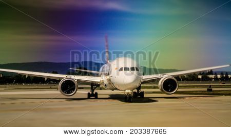 Airplane On Tarmac At Airport About To Take Off Or After Landing