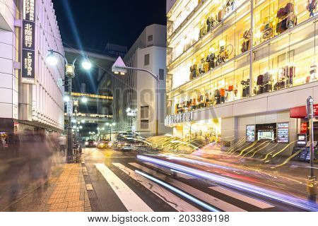 TOKYO, JAPAN - NOVEMBER 12, 2016: Busy streets of Shibuya district in Tokyo at night, Japan. Shibuya is the shopping district which surrounds Shibuya Station, one of Tokyo's busiest railway stations.
