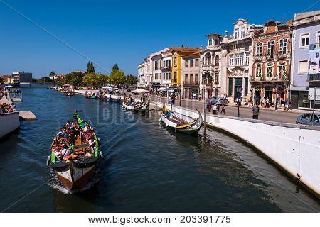 Aveiro Portugal - September 01 2017: Moliceiro boat strolling tourists through the ria of Aveiro Portugal.
