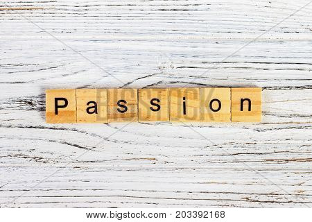 Passion word wood block on table for business concept.
