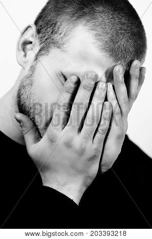 portrait of stressed young man with hands on a face lonely sad negative emotions