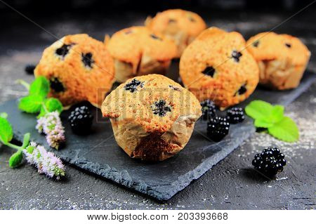 BlackBerry muffins with fresh berries and mint