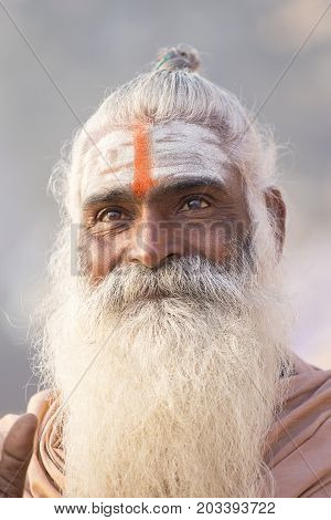 VARANASI INDIA - JANUARY 25 2017 : Portrait of Shaiva sadhu holy man on the ghats of the Ganges river in Varanasi India . Close up