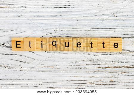 ETIQUETTE word made with wooden blocks concept