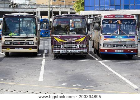 PORT LOUIS MAURITIUS - MARCH 06 2017 : Regular public buses at the bus station. Buses are the most widespread public transport type in Mauritius