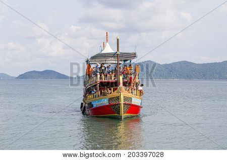 KOH CHANG THAILAND - MAY 01 2017 : Colorful boat with tourists returns from a cruise to the island of Koh Chang Thailand. The island Koh Chang is very popular among tourists.