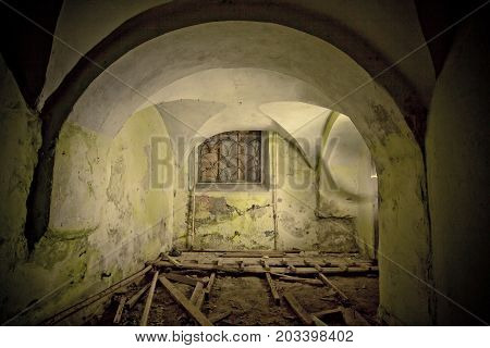 Creepy underground cellar under old haunted historical mansion