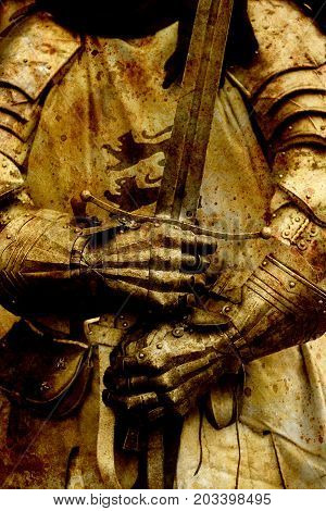 Detail knight armor. Gloves and sword of a knight