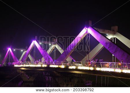 Dhaka, bangladesh, august 2017- young indian people spend their holidays at hatil jhil bridge with family near hatiljhil bridge Bridge in dhaka in bangladesh taken on 7, september 2017.