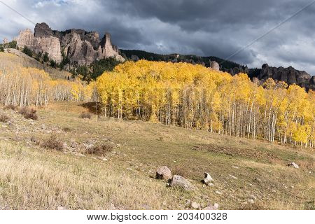 High Mesa Pinnacles in Cimarron Valley Colorado.  Early Fall with approaching storm.